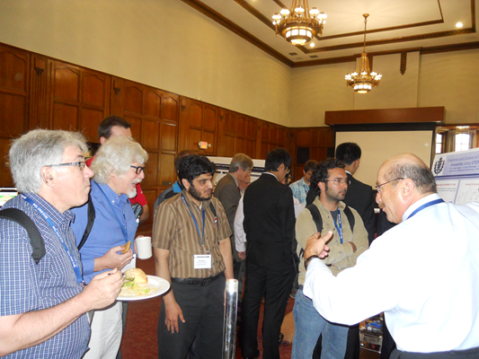 Prof. Nejat Olgac is presenting the research on thermoacoustic instability prediciton and control to an audience including Prof. Erik Verriest (GATECH) (second from left).